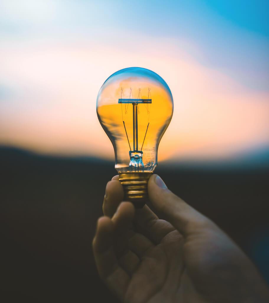 hand-is-holding-lightbulb-idea-etrunity